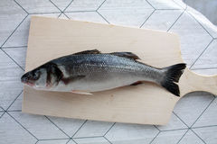Sea bass. on the table Royalty Free Stock Photo