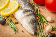 Sea Bass with vegetables and lemon Royalty Free Stock Images