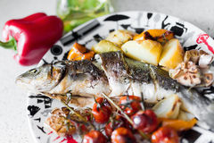 Sea bass with vegetables Royalty Free Stock Photos