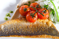 Sea Bass With Roasted Cherry Tomatoes Stock Image