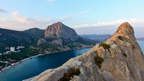 Sea Bay from a bird`s-eye view between two rocky mountains at sunset. royalty free stock images