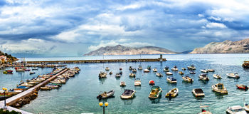 Sea bay docks with yachts, small boats and motorboats Stock Photo