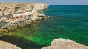 Sea bay of emerald color near coastal cliffs. Bay with transparent water of emerald color near white coastal cliffs stock video
