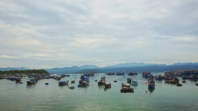 Sea Bay with Fishing Boats Hills Cloudy Sky in Vietnam. Panorama of tranquil sea bay with Vietnamese fishing boats against distant hills cloudy blue sky stock footage