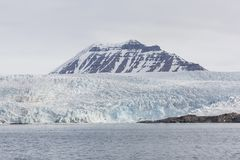 Sea bay with a glacier and icebergs in Svalbard, Spitsbergen. Norway Stock Images