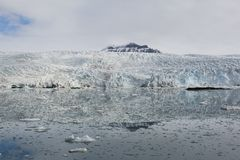 Sea bay with a glacier and icebergs in Svalbard, Spitsbergen Royalty Free Stock Photo