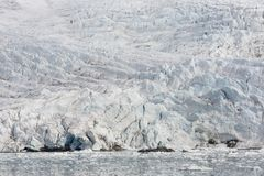Sea bay with a glacier and icebergs in Svalbard, Spitsbergen. Norway Royalty Free Stock Images