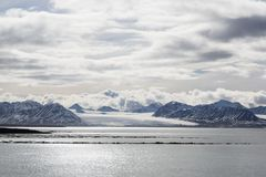 Sea bay with a glacier and icebergs in Svalbard, Spitsbergen. Norway Royalty Free Stock Photography