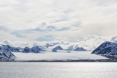Sea bay with a glacier and icebergs in Svalbard, Spitsbergen. Norway Royalty Free Stock Photos
