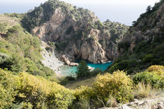 Sea bay hidden among mountains. Beautiful Delik Deniz sea bay hidden among mountains in Guney koyu village surrounded by remains of Antiochia ad Cragum Royalty Free Stock Photos