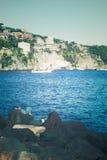 Sea bay lagoon boat fisherman stones Italian resort retro Royalty Free Stock Photography