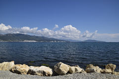 Sea bay landscape Tsemess. Mountains and clouds in the sky. In the distance can be seen the Marine cargo port Royalty Free Stock Photos