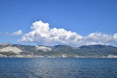Sea bay landscape Tsemess. Mountains and clouds in the sky. In the distance can be seen the Marine cargo port Stock Photo