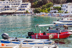 Sea bay of Loutro tona with small beach full of tourists and parked boats on Crete island, Greece Royalty Free Stock Images