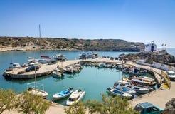Sea bay with moored boats in Kolymbia harbor Stock Photo