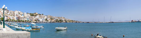 Sea bay with moored boats. Promenade in Mediterranean town Sitia Stock Image