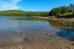 Sea bay and forest on the shore. Sea bay near the Holy Trinity Anzersky skete of the Solovki monastery on the Anzersky island, the Solovki islands, Arkhangelsk stock images