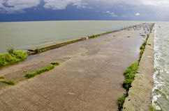 Sea bay pier after storm Royalty Free Stock Image