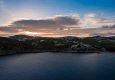 Sea bay at sunset on the island of Mykonos - Agia Anna. Royalty Free Stock Photo