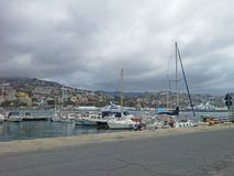 Sea bay with yachts and boats at cloudy day in San Remo, Italy, view from city Sanremo, Italian Riviera. Sea bay with yachts and boats at cloudy day in San Remo Royalty Free Stock Photos
