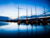 Sea bay with yachts at sunset Stock Photography