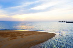 The sea and the beach. At sunset at night, very charming Stock Photos