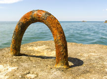 On a sea beach. Rusty metal loop on a sea beach Royalty Free Stock Photo