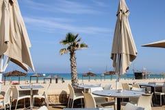 Sea and Beach bar with umbrellas Stock Photos