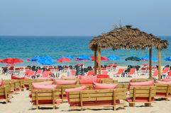 Sea and Beach bar with umbrellas Stock Images
