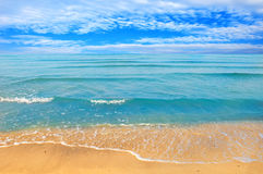 Sea beach blue sky sand sun daylight Stock Image