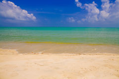 Sea beach blue sky sand sun daylight Royalty Free Stock Images