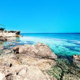 Sea beach blue sky sand sun daylight relaxation rock landscape / Stock Image
