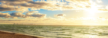 Sea beach with blue sky and snow Royalty Free Stock Photo