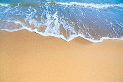 Sea Beach with  blue surf of wave and yellow sand Stock Photos