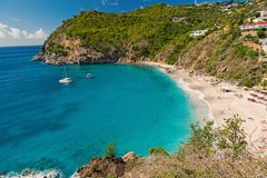 Sea beach with blue water, white sand and mountain landscape in gustavia, st.barts. Summer vacation on tropical beach. Recreation, leisure and relax concept stock images