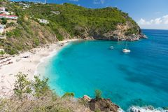 Sea beach with blue water, white sand and mountain landscape in gustavia, st.barts. Summer vacation on tropical beach. Recreation,. Leisure and relax concept Royalty Free Stock Photos