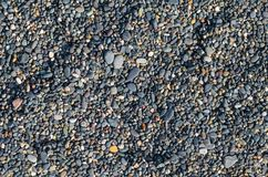 Sea beach covered with pebles stock images