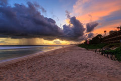 Sea  and beach with dark rain clouds at sunset Royalty Free Stock Images