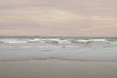 Sea and beach in evening time Stock Images