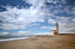 Sea and beach, long exposure shot, with a church Royalty Free Stock Image