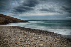 Sea and beach, long exposure shot Stock Images