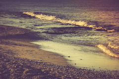 Sea beach in the morning. Filtered image:cross processed vintage effect Royalty Free Stock Photography