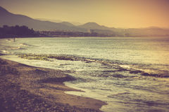 Sea beach in the morning. Filtered image:cross processed vintage effect Royalty Free Stock Images