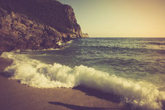 Sea beach in the morning. Filtered image:cross processed vintage effect Stock Images