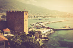 Sea beach in the morning. The old fortress and Mediterranean sea in Alanya, Turkey. Filtered image:cross processed vintage effect Stock Photography