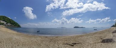 The sea and the beach at noon. The bright sky, the clouds are white.Sea atmosphere at Sairee Beach, Chumphon Province, March
