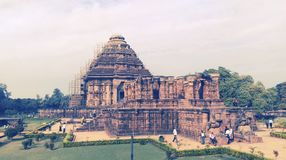 SEA BEACH IN ORISSA. The Konark Sun Temple was built from stone in the form of a giant ornamented chariot dedicated to the Sun god, Surya. In Hindu Vedic royalty free stock image