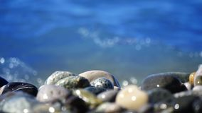 Sea beach of peebles with the foam of the waves in motion stock footage