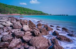 Sea beach with rocks and blue sky background royalty free stock photos