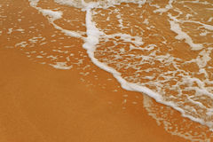 Sea beach sand with foamy wave a lot of space for text Stock Photo